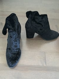 pair of black suede boots