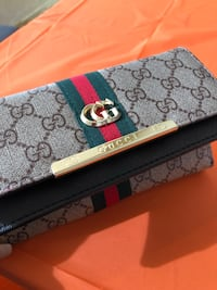 white and gray Gucci leather belt