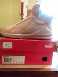 pair of white Puma basketball shoes with box