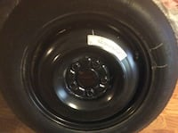 black 5-lug steel wheel and tire Alexandria, 22315