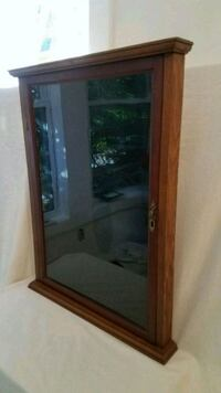 Vntage pine cabinet with original glass.