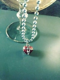 Heart shaped silver and red enamel box with neckla