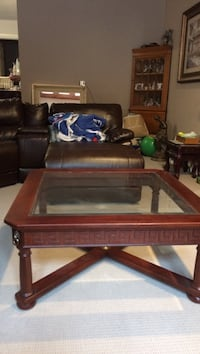 Brown wooden framed glass top coffee table from DeBoer's Pickering, L1V