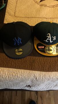 two black New York Yankees and black and yellow Oakland Athletics snapback caps Dallas, 75228