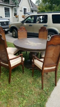 round brown wooden table with four chairs dining s Niagara Falls, L2G 5V2