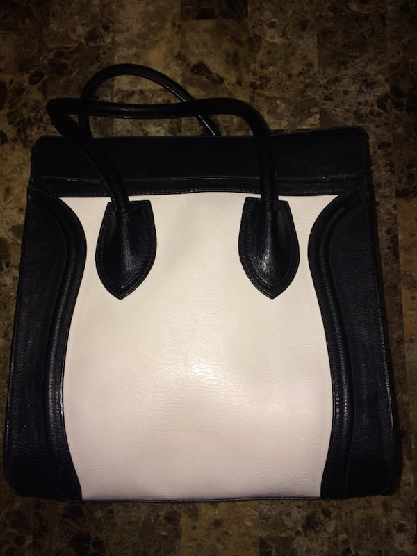 White and black leather bag 249c5be8-66fe-4c83-93aa-b6939e893691