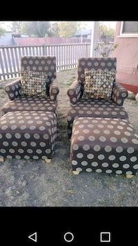 two brown-and-black polka-dot armchairs 2345 mi