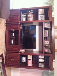 brown wooden TV hutch with flat screen television Kissimmee, 34758