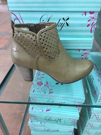 pair of brown leather heeled booties Montréal, H3S 2T5