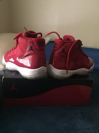 pair of red Nike basketball shoes Houston, 77061