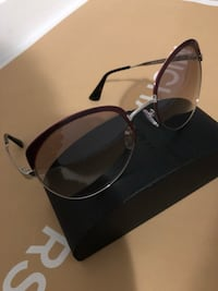 Prada Sunglasses 100% authentic  Winter Garden, 34787