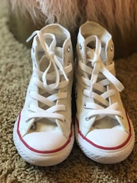 pair of white Converse All Star high-top sneakers