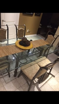Rectangular glass top table with chairs. In excellent condition! No stains no rips. Looking to sell fast! Bolton, L7E 2J8