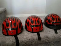 three black-and-red flame-pattern skateboard helmets Carson City, 89701