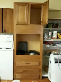 Brn tall kitchen cab. Microwave  or oven insert Colorado Springs, 80909