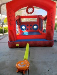 Sixflags obsiticle coarse bounce house with basketball hoop