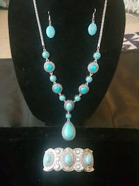 silver-colored necklace and bracelet with turquoise gemstone