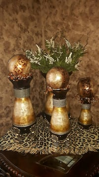 three brown ball decors with vases