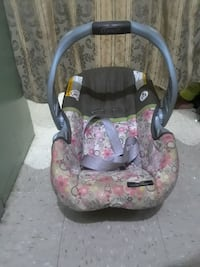 baby's gray and pink car seat carrier