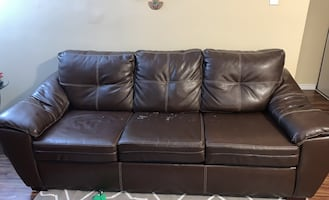 Brown couch for sale. Functions perfectly, shows wear