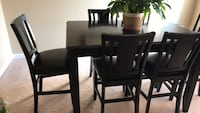 Extendable wooden dining  table and 8 chairs. Laurel, 20707
