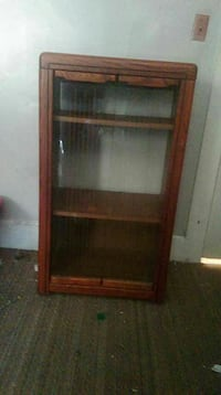 Brown Wooden Display Stereo Cabinet on wheels Evansville, 47712