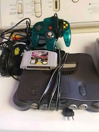 black Nintendo 64 console with controllers and game cartridges Ontario, 91762