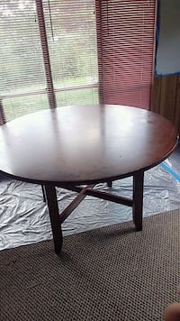 round black wooden table with black metal base Altoona, 35952