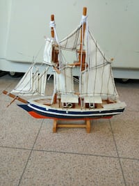 blue and white sail boat miniature