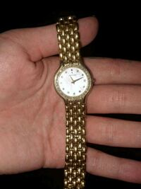 round gold-colored analog watch with link bracelet 2338 mi