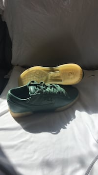 pair of green Nike running shoes
