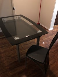 Black and gray glass top table with 4 chairs Montgomery Village, 20886
