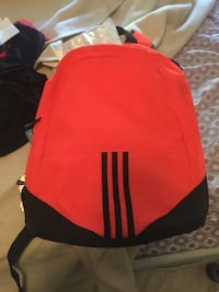 orange and black adidas brand new