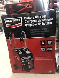 Black and red Century battery charger box