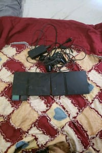 2 Ps2 consoles with games both work well  Sarnia, N7T 1E8