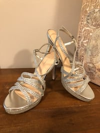 Pair of silver open-toe ankle strap heels Lakeland