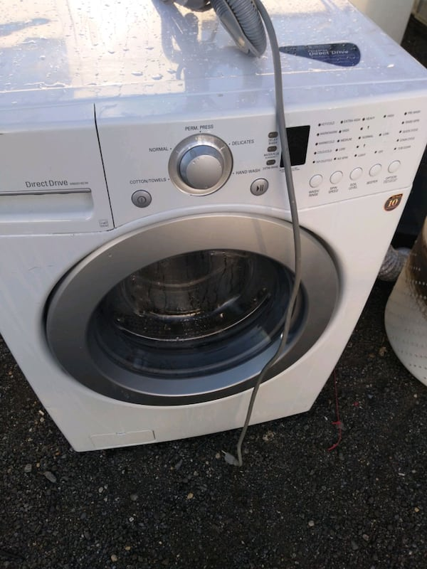 LG full size front load washer works good 6-month warranty free delive aaff19bb-cc6c-4d30-94c4-d36d5c14b6f5