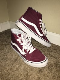 Pair of red-and-white Vans Sk8 Hi