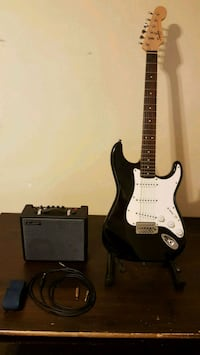 black and white stratocaster electric guitar, amp Vancouver, V5W 3B3