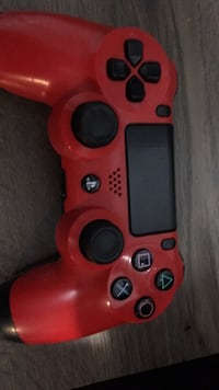 orange and black Sony PS4 controller Toronto, M6B 2G8