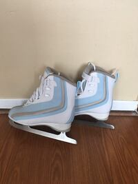 pair of gray-and-white ice skates