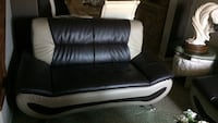 Black and beige leather loveseat Calgary, T3J 0C3