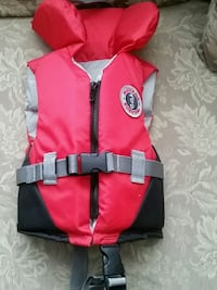 red and black Mustang Survival life vest