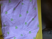 Purple stripped crib sheet with green birds