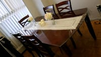 brown wooden dining table with chairs Toronto, M3N 2K8