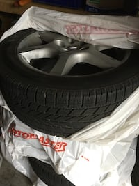 4 winter tires and nissan mags. tires and mags in great shape lots of thread left. 215/55-17 toyo tires. 5x114.3