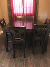 rectangular brown wooden table with four chairs dining set Welland, L3C 6S3