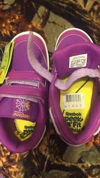 pair of purple-and-yellow Reebok athletic shoes