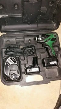 green and black Hitachi cordless hand drill with c