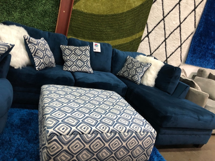 Microfiber sectional with pillows. Brand new. Ottoman $275 extra.